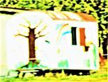 Bunt bemalter Wohnwagen von Herrn Groot-Bramel