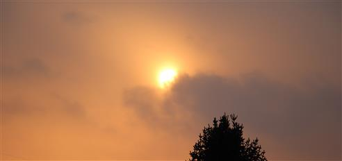 Sonne im Februar hinter einer Wolke